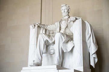 Statue of American president Abraham Lincoln seated in white marble at Lincoln Memorial in Washington DC, USA