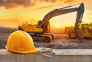 Yellow hard hat on construction site Wall mural
