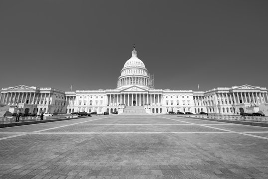 Front view of the Capitol Building with the Senate and House of Representatives in Washington DC, USA in bleak black and white