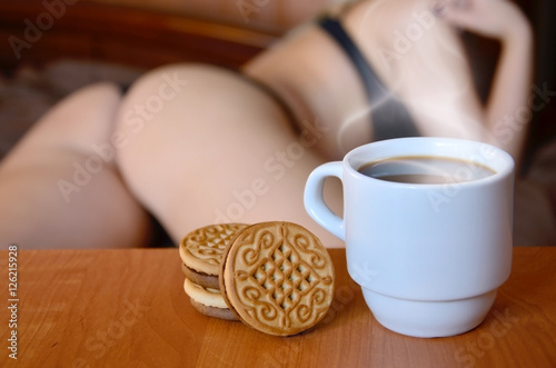A Cup Of Hot Coffee And Round Cookies With Silhouette Y In