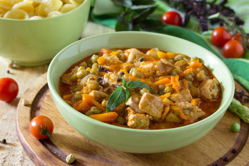 Traditional hot ragout with meat and vegetables stewed in tomato