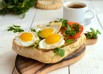 Bruschetta with quail egg, bell pepper, herbs and a cup of coffe