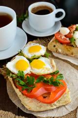 Bruschetta with quail egg, bell pepper and herbs. Light breakfast.