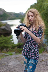 beautiful girl photographer on the background of beautiful nature