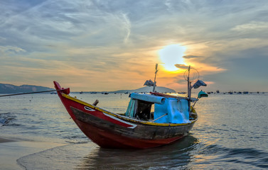 Fishing boat before dawn as the sun slowly rise to express the rest of the season when fishermen fish on, languish waiting to be put to sea
