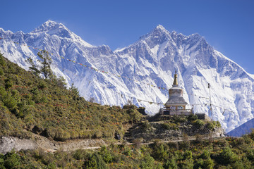 View of a Buddhist stupa with mountain Lhotse behind on the way from Namche Bazaar to Tengboche of the everest base camp trekking route.