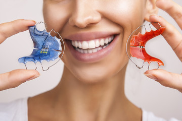 Beautiful Smiling Girl with Retainer for Teeth, Close-up