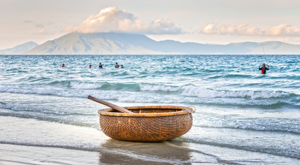 Alone basket boat beachside in the morning. This means fishing mainly of fishermen in sea areas of Vietnam