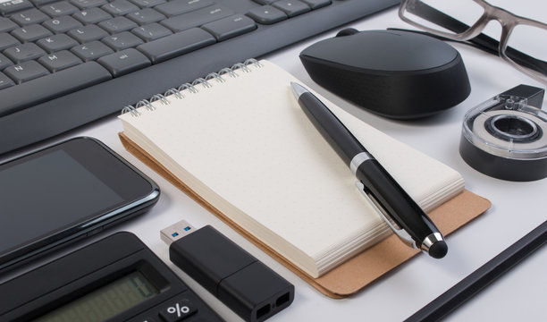 Flatlay of business office stuff isolated on white. Business office supplies or business office stationery object on white. Flatlay of stationeries or business office stuff.