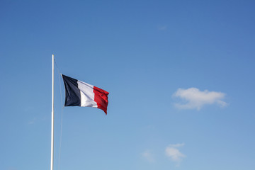 French flag with blue sky as background