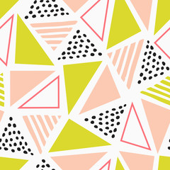 Abstract seamless patten with geometric shapes in pink, green and black.