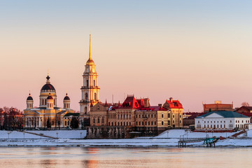 City landscape. Country Russia, Rybinsk. Embankment of the Volga River. A small town in the rays of the setting sun.