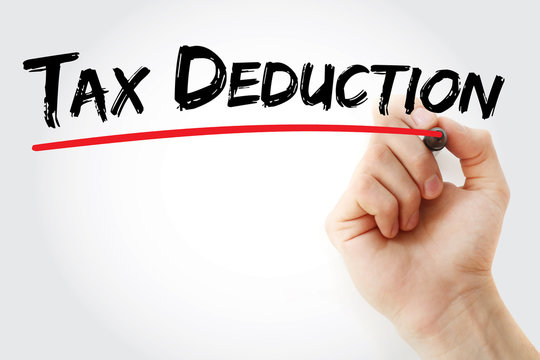 Hand writing Tax deduction with marker, concept background