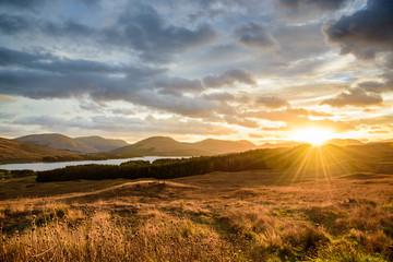 Spectacular sunset at Glencoe, Scotland, UK - amazing scenery under the gentle light of the setting sun on a beautiful autumn day