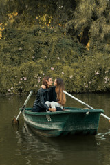 Couple embracing in boat in river.
