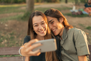 Young couple taking selfie at smartphone.