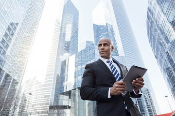 Afro american businessman using a Tablet pc