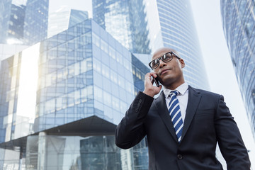 Afro american businessman talking on mobile phone