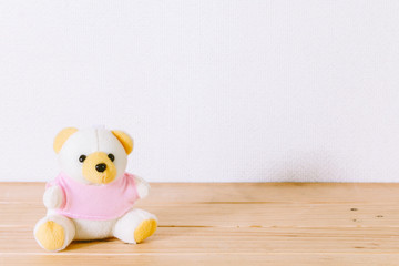 Teddy Bear toy alone on wooden table