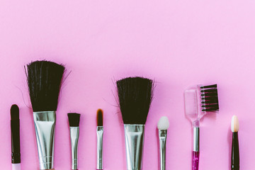 Makeup brush on pink background
