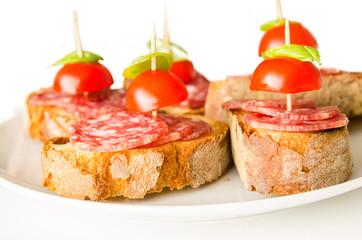 Crostini with salami, tomato and basil, Italian Appetizers