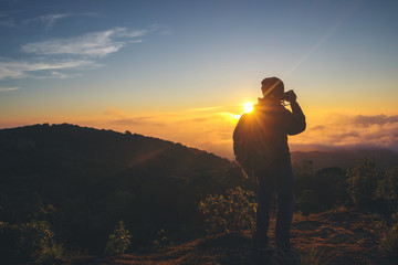 silhouette of photographer taking photo at sunset
