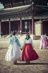 Young girls in traditional dresses at Gyeongbokgung Palace of Seoul, South Korea.