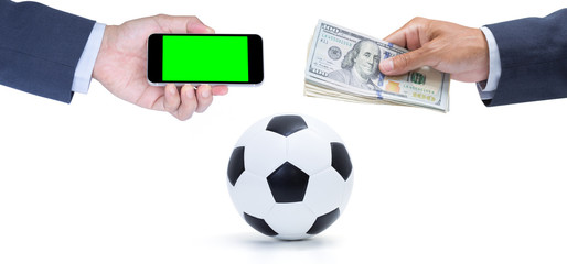 Hand holding blank green screen mobile phone and banknote with soccer ball on white background
