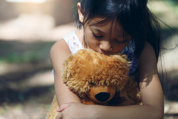 Asia Lovely girl sad mood Hug teddy bear