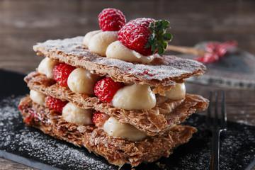Millefeuille dessert with strawberries dessert sweet on black background cake