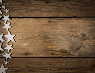 white stars on wooden table. Christmas background