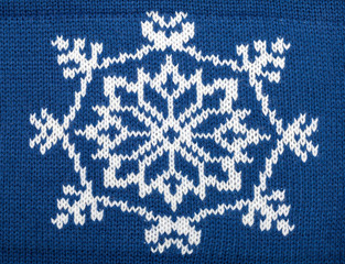Blue knitted fabric cloth with christmas ornament
