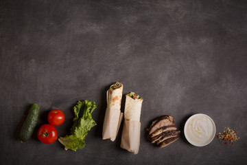 Doner kebab - fried beef meat with vegetables. Copy space for text