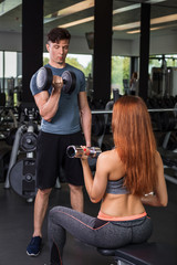 happy cutie athletic girl , execute exercise with dumb-bells