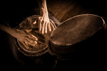 People hands playing music at djembe drums