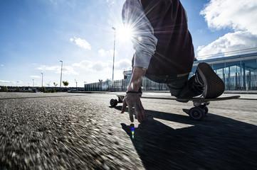 Cool street skateboarder in a urban scene.