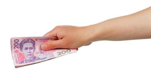 Ukrainian money 200 hryvnia in female hand isolated on white.