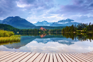 The view of mountain landscape with lake from wooden pier.