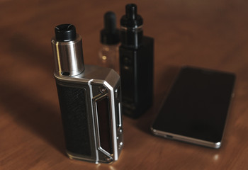 E-cigarette for vaping, dripping atomizer, liquid for vape and mobile phone