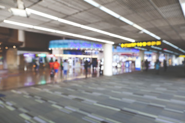Blurred image people walking and shoping in duty free shop at airport