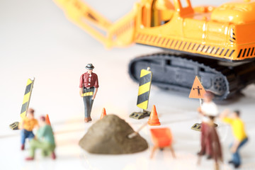 Construction toy / View of construction site of mini toy worker on white background.