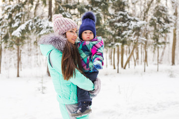 Happy family. Mother and child girl on a winter walk in nature.