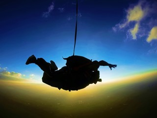 Skydiving tandem sunset silhouette