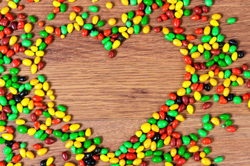 Colored candy lined heart. Declaration of love on the day of St. valetina.