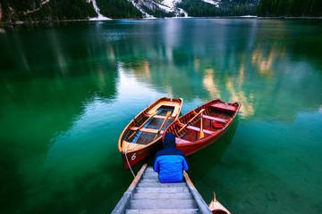 Man alone at the Braies Lake ( Pragser Wildsee ) in Dolomites mo