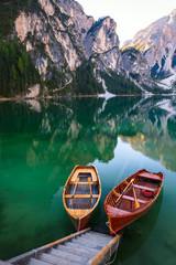 Boats on the Braies Lake ( Pragser Wildsee ) in Dolomites mounta