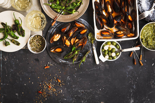 Dinner Table With Mussels, Grilled And fresh Vegetables. Copy Space