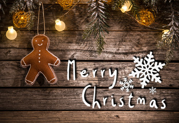 Christmas crafted decoration on wooden background.