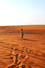silhouette of a girl in the setting sun in the desert in the Uni