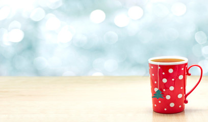 Cup of tea on the table. Christmas wallpaper.